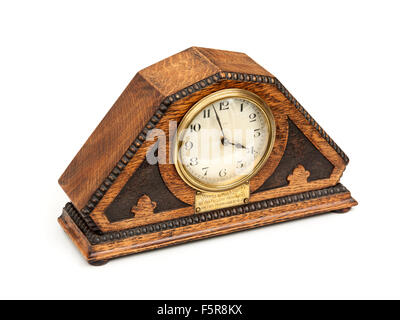 Antique (1929) Art Deco wooden mantel clock with French mechanism. - Stock Photo