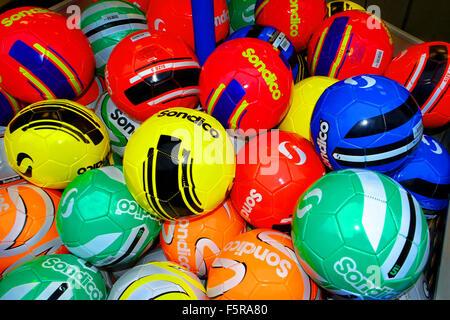 Multi coloured footballs, red, green, blue, yellow, orange