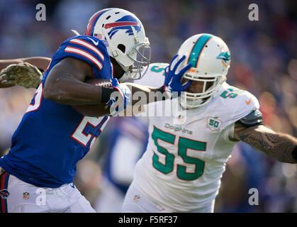 Orchard Park, Florida, USA. 8th Nov, 2015. Buffalo Bills running back LeSean McCoy (25) stiff arms Miami Dolphins - Stock Photo