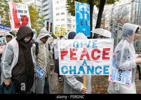 Tokyo, Japan. 08th Nov, 2015. Demonstrators hold placards against the Japan's new security law during a protest - Stock Photo