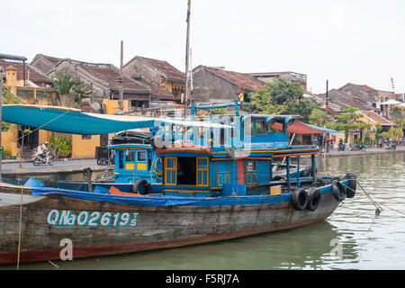 Hoi An ,central coast of Vietnam, fishermans boat on Thu Bon River in centre of Hoi An. - Stock Photo