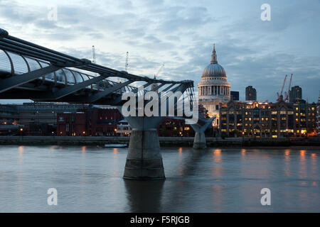 View of Millennium Bridge leading into St Paul's Cathedral London, UK - Stock Photo