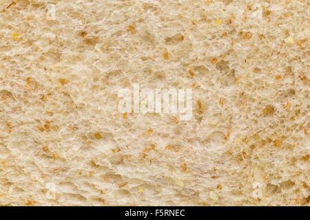 Macro shot of whole wheat bread surface. - Stock Photo