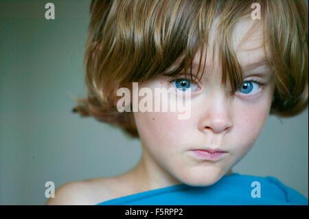Sweden, Vastergotland, Lerum, Portrait of blue eyed boy (8-9) - Stock Photo