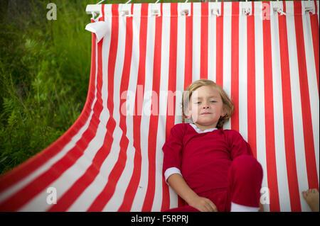 Sweden, Dalarna, Leksand, Boy (6-7) in hammock - Stock Photo