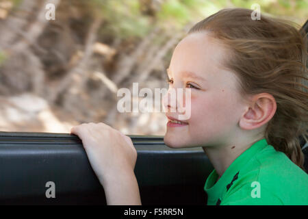 Greece, Karpathos, Amopi, Boy (8-9) inside car - Stock Photo