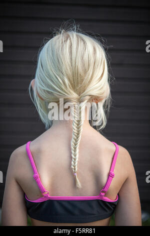 Sweden, Vastergotland, Lerum, Rear view of girl (8-9) with braided hair - Stock Photo