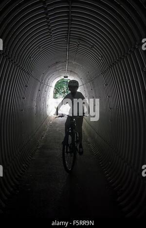 Sweden, Vastergotland, Lerum, Portrait of boy (10-11) on bicycle - Stock Photo
