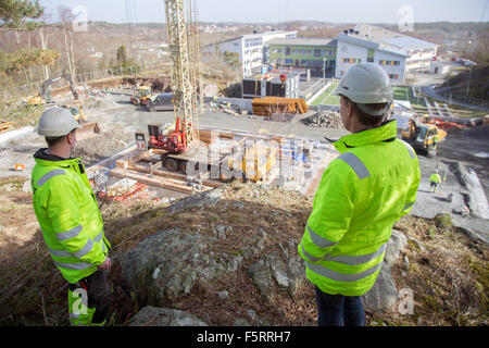 Sweden, Bohuslan, Torslanda, Two workers at construction site - Stock Photo