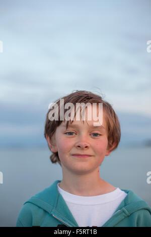 Sweden, Halland, Onsala, Portrait of boy (12-13) outdoors at dusk - Stock Photo