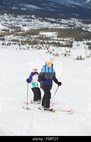 Norway, Hedmark, Trysil, Two children (10-11, 12-13) skiing in mountains - Stock Photo