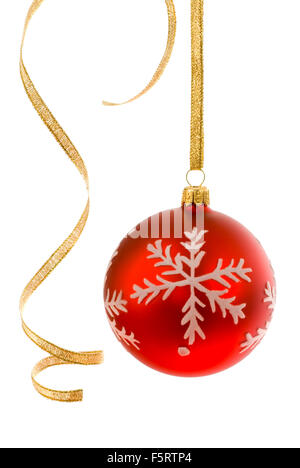 Red bauble on white, accompanied by some curly golden ribbon - Stock Photo