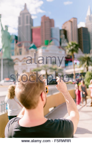 USA, Nevada, Las Vegas, Man taking picture with smart phone - Stock Photo