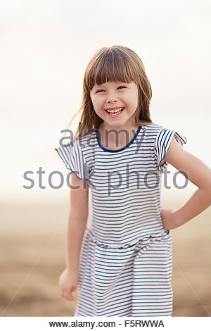 Spain, Las Palmas, Portrait of smiling little girl (4-5) - Stock Photo