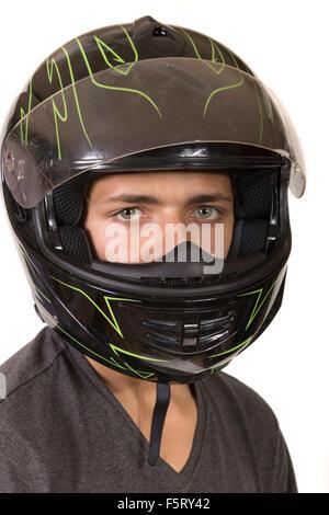 Teenage boy wearing a crash helmet - Stock Photo