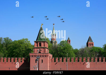 Russian Mil Mi-24 helicopters flying in formation over the Kremlin during the 2009 Moscow Victory Day Parade in - Stock Photo