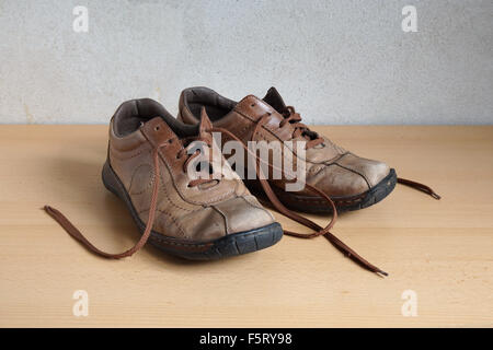old worn out shoes - Stock Photo