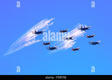 Russian MIG-29 and Su-27 fighter jets flying in front of decoy countermeasure flares over the Red Square in Moscow, - Stock Photo