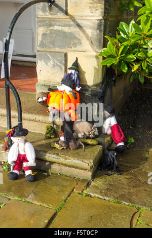 Yarn Bombing decorating public place with knitted objects here a Halloween theme witches pumpkin bats outside Community - Stock Photo