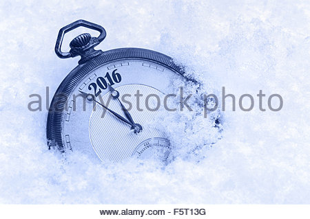 Pocket watch in snow, New Year 2016 greeting card - Stock Photo