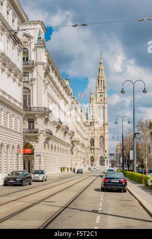 Austria, Vienna, City street with Vienna City Hall in background - Stock Photo