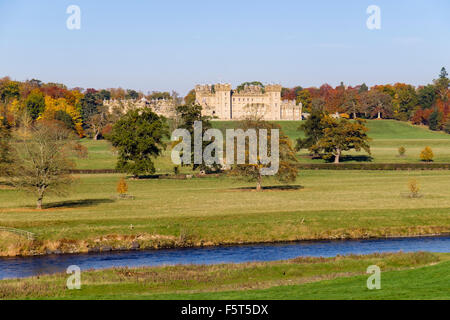 Floors Castle and grounds in autumn from across River Tweed. Kelso Berwickshire Scottish Borders Scotland UK Britain - Stock Photo