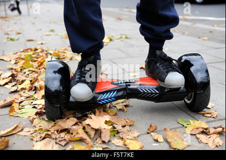 Young man riding a Hoverboard on a Public Footpath in London. They are now banned in all public places in the United - Stock Photo