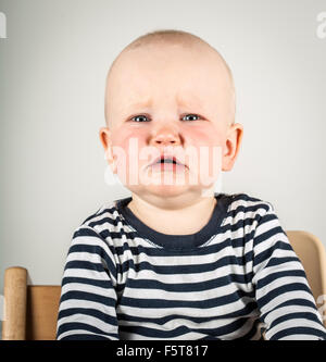 Finland, Portrait of boy (2-3) crying - Stock Photo
