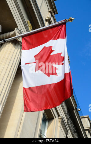 The Canadian Flag hands outside the Canadian Embassy, Trafalgar Square, London, England, UK - Stock Photo