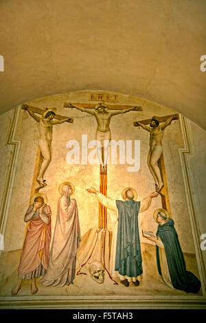 'Crucifixion' by Fra Angelico Crucifixion with Mourners and Sts Dominic and Thomas Aquinas (Cell 37) Convento di - Stock Photo