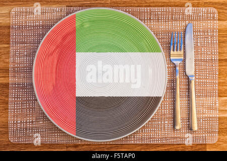 Dinner plate with the flag of the United Arab Emirates on it for your international food and drink concepts. - Stock Photo