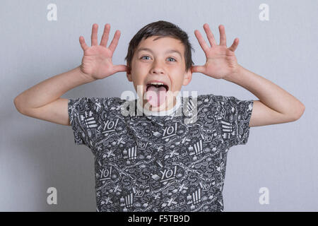 Pre-teen boy sticking his tongue out - Stock Photo