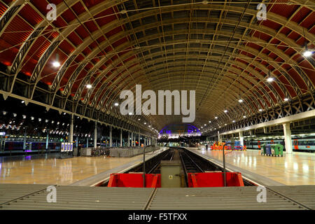 A view looking along platforms 10 and 11 at London Paddington Railway station showing the buffers and lighting at - Stock Photo
