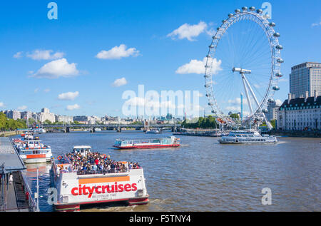 River Thames cruise boats and The London Eye on the South Bank of the River Thames London England GB UK EU Europe - Stock Photo