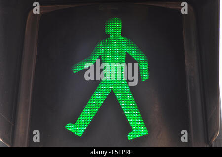 Green man in traffic light, indicating it is safe to walk and cross the road, Spain - Stock Photo