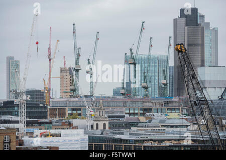 London, UK. 09th Nov, 2015. The City is a forest of cranes, indicating that construction work continues apace around - Stock Photo