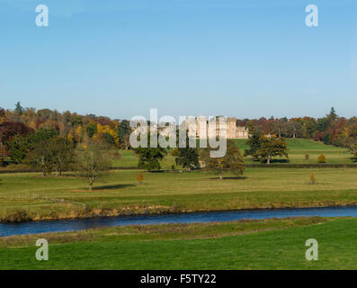 View across River Tweed to historic architecture landmark building Floors Castle Kelso Scottish Borders part of - Stock Photo