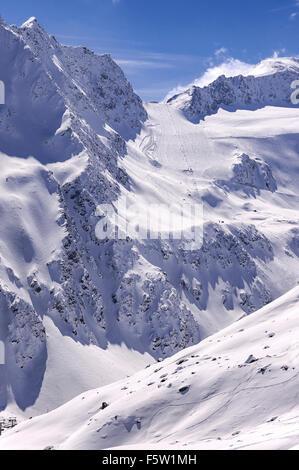 Ski tow and steep run on Rettenbach Glacier in Solden ski resort in Otztal Alps in Tirol, Austria - Stock Photo
