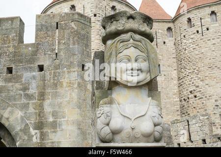 Modern statue,Dame Carcas,Porte Narbonnaise or Narbonne Gate entry to La Cité, Carcassonne Castle,Fort,Aude,France - Stock Photo
