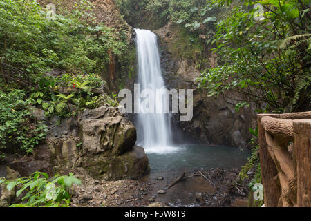 Distant view of blurred La Paz Waterfall amongst the rainforest, Costa Rica - Stock Photo