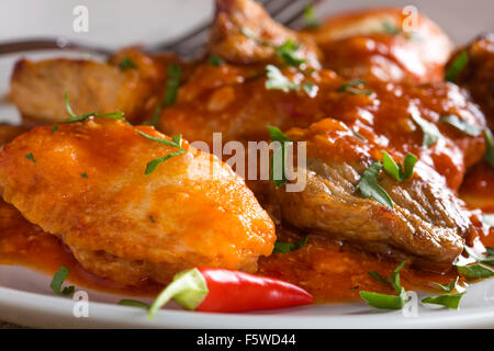 Classic Hungarian goulash with dumplings, delicious heavy food, homemade dumplings - Stock Photo