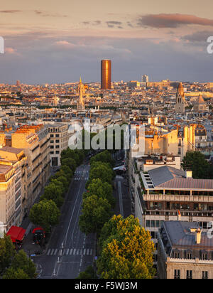 Sunset light on Montparnasse Tower and Avenue Marceau rooftops in the 16th arrondissement, Paris, France - Stock Photo