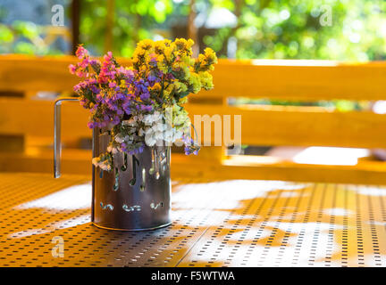 Bouquet of dried flowers in a cup - Stock Photo