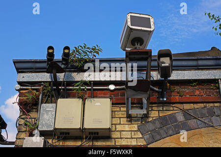 laser  microwave  camera CCTV receivers transmitters all mounted on the side of a building looking over us all - Stock Photo