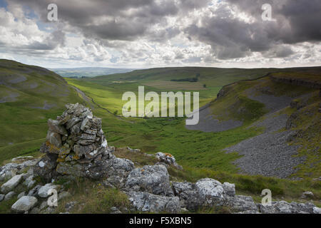 View down Crummackdale from the summit cairn at Moughton Scar Limestone Pavement, Crummackdale, Yorkshire Dales, - Stock Photo