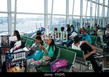 Passengers, Departure Lounge, Hong Kong International Airport, Chek Lap Kok island, Hong Kong - Stock Photo