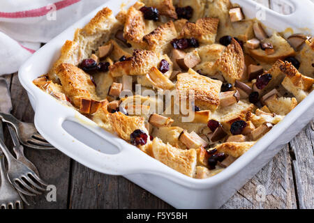 Bread pudding breakfast casserole with pear and dried cranberry - Stock Photo