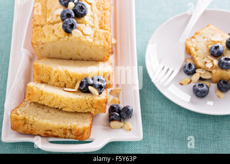 Lemon blueberry pound cake with fresh blueberries and sliced almonds - Stock Photo
