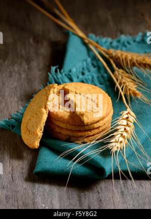 crispy cereal cookies on rustic wooden table - Stock Photo