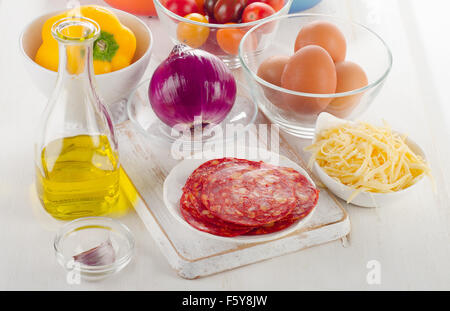 ingredients for baked eggs with vegetables and chorizo. Spanish breakfast - Stock Photo